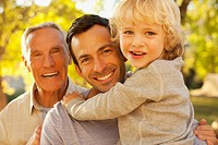 Three generations of men smiling together