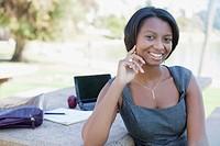 Businesswoman working in park