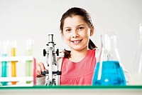 Girl sitting in front of a microscope