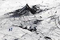 People on the glacier tongue of Sólheimajoekull, Mýrdalsjoekull Glacier, Suðurland, South Iceland, Iceland, Europe