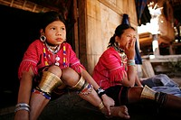 Young girls outside a house in the refugee camp Approximately 300 Burmese refugees in Thailand are members of the indigenous group known as the Longne...