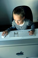 Girl, 9 years, with an iMac computer