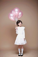 A girl holding the balloons