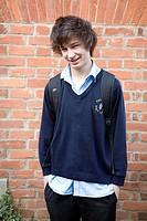 Teenage boy portrait  portrait of teenage boy wearing navy blue school uniform