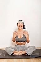 Woman on an exercise mat, doing yoga or gymnastics