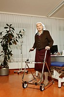 Old woman with a wheeled walker