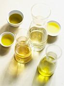 Bottles and bowls of olive oil