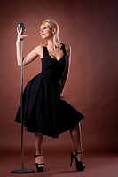 woman pin_up portrait in black with microphone