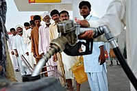 Charity organisation distributing fuel to power diesel pumps which are used to help fill the irrigation channels to water the fields which were destro...