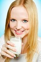 Lovely teenager girl drinking milk