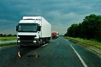 Trucks on wet asphalt