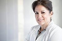Portrait of smiling female doctor in hospital