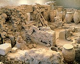 Pithoi unearthed at the archaeological excavation site in Akrotiri on Thera, now Santorini, Greece. Minoan civilization, 16th Century BC.