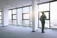 Businessman standing in empty office