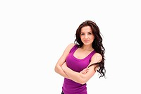 Brunette with arms crossed in purple tank top against white background