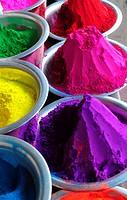 Bowls containing colorful powder for the traditional celebration of holi festival in India,Mysore market,Karnataka,South India,Asia