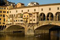 Rowers on the Arno River and gondolas moored underneath the Ponte Vecchio, Florence, UNESCO World Heritage Site, Tuscany, Italy, Europe