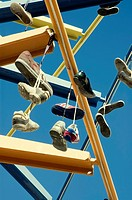 Shoes hanging of a sculpture in Valencia, Spain