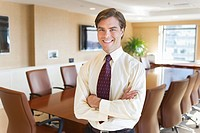 Portrait of businessman in board room