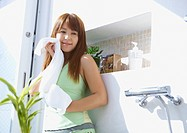 Middle_aged woman holding a towel