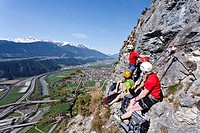Mountain climbers ascending the Kaiser Max climbing route on Martinswand near Innsbruck, looking over the Inntal Valley and Zirl, North Tyrol, Tyrol, ...