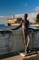 Dammglonker statue at the port of Langenargen in winter, Montfort Castle at the back, Lake Constance, Baden-Wuerttemberg, Germany, Europe