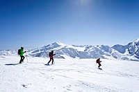 Ski tourers descending Mt. Hintere Schoentaufspitze, Solda in winter, behind Mt. Zufallspitze and Mt. Cevedale, South Tyrol, Italy, Europe