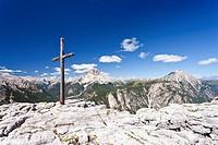 Cross on the summit of Monte Piano mountain, view, Hochpustertal valley, Dolomites, Croda Rossa mountain at the back, province of Bolzano-Bozen, Italy...