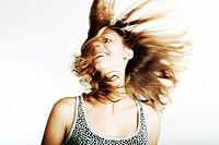 Young woman waving her long hair, portrait
