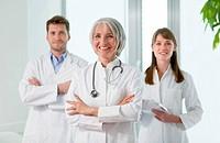 Doctors smiling together in hospital