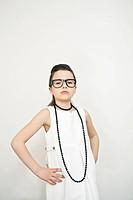Frowning girl wearing eyeglasses