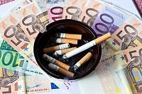 Smoking costs money, euro bank notes and ashtray