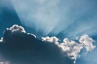 Germany, Sunbeam through cloudscape