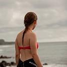 Woman on the coast looking at a view, Playa Ochoa, San Cristobal Island, Galapagos Islands, Ecuador