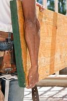 Carpenter lifting a beam