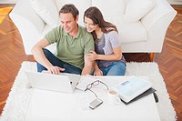 Hispanic couple using laptop together