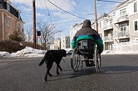 Woman with multiple sclerosis in a wheelchair with a service dog