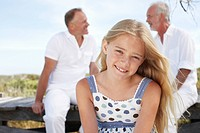 Girl with her father and grandfather