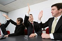 Business colleagues giving a high five