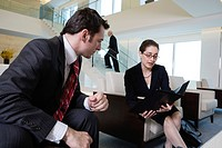 View of businesspeople discussing in an office