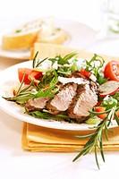 Rosemary steak on rocket salad