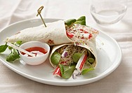 Wraps filled with surimi, bean sprouts and lamb´s lettuce