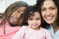 Portrait of a mid adult couple smiling with their daughter