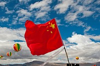 Flag of the People's Republic of China during the traditional festival of the tribes in Gerze, Western Tibet, Asia