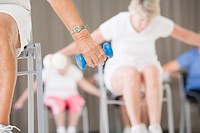 Senior woman exercising with a hand weight