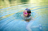 girl with underwater glasses swimming on a river , Villahermosa river, Ludiente, Castellón, Spain