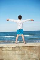 Boy playing at the beach, El Saler beach, Albufera de Valencia Nature Reserve, Spain, Valencia