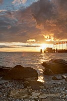 Germany, Nonnenhorn, View of jetty with lake and rocks at sunset