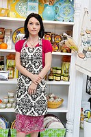 Mid adult woman standing in cake shop