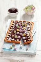 Mazurek Polish Easter cake with chocolate, almonds and sugar eggs